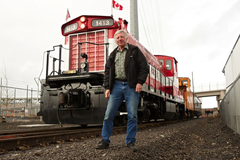 by: TRIBUNE PHOTO BY JAIME VALDEZ - Richard Samuels who is the owner of Oregon Pacific Railroad Co., stands in front of his 1959 General Motors Diesel at the Oregon Rail Heritage Center. Samuels gives rides to passengers on the locomotive as well as a Pullman business rail coach car.
