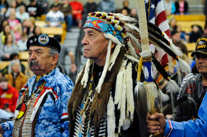by: TIMES PHOTO: JOHN LARIVIERE - Chief Chewesclaw (William DePoe), great-grandson of Siletz Chief William DePoe for which the city of Depoe Bay is named, prepares to lead dancers and honored veterans during the grand entry.