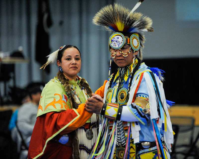 by: TIMES PHOTO: JOHN LARIVIERE - Love Richardson, a member of the tribal council woman for the Nipmuc Nation dances with David Yelloweyes, Northern Cheyenne Native American, during a couples dance at the PCC WACIPI Winter Powwow.