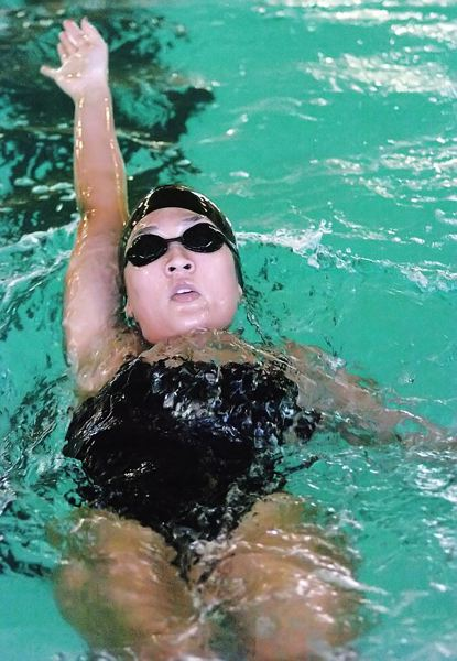 by: DAN BROOD - REACHING -- Tigard sophomore Sage Wagehaupt strides out in backstroke leg of the 200 individual medley.