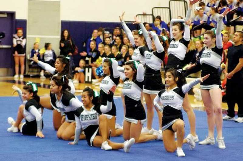 by: PHOTO COURTESY OF NORTH MARION CHEER - The North Marion cheer team completes their routine at Lake Oswego High School on Jan. 11. The Huskies placed third at the competition a week before taking second place at Lakeridge High School on Saturday.