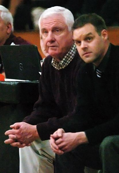 by: DAN BROOD - LEADER -- Dave Brown watches the action during last year's Class 3A state tournament.