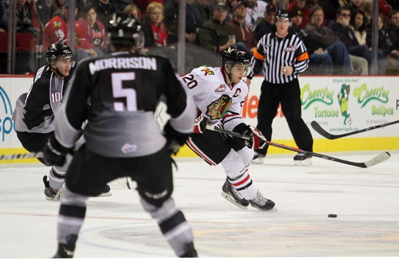 by: TRIBUNE PHOTO: JONATHAN HOUSE - Portland Winterhawks captain Taylor Leier looks to pass in Monday's game against the Vancouver Giants.