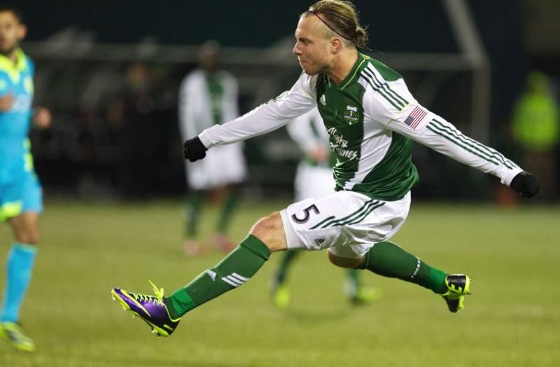 by: TRIBUNE PHOTO: JAIME VALDEZ - Portland Timbers defender Michael Harrington follows through after making a cross against Seattle.