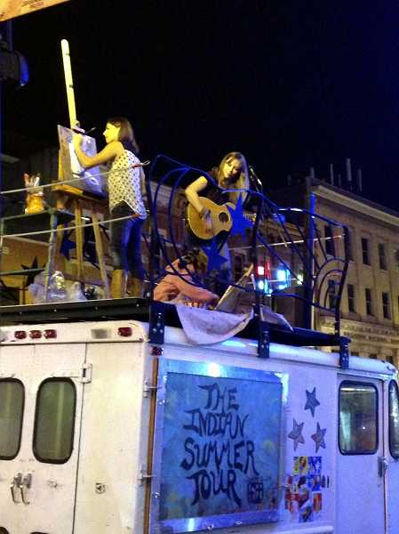 by: COURTESY OF JEN HARLOW - Jen Harlow, Amelia Stanaway (middle, bottom) and Amanda Stanaway perform atop the ice cream truck they took on a cross country trip last fall.