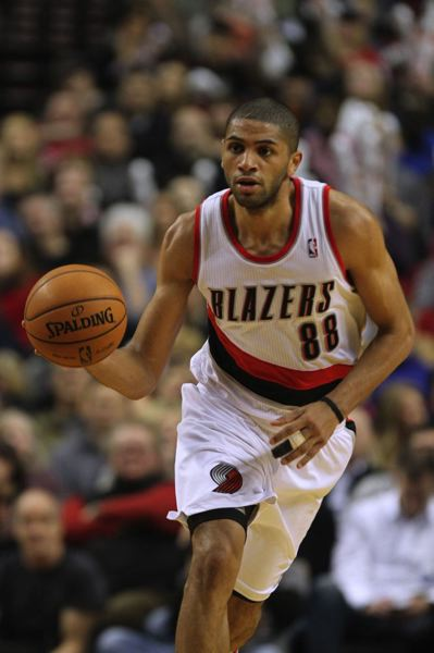 Nicolas Batum drives up the court.