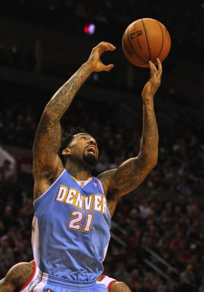 Wilson Chandler of the Nuggets gets a rebound.