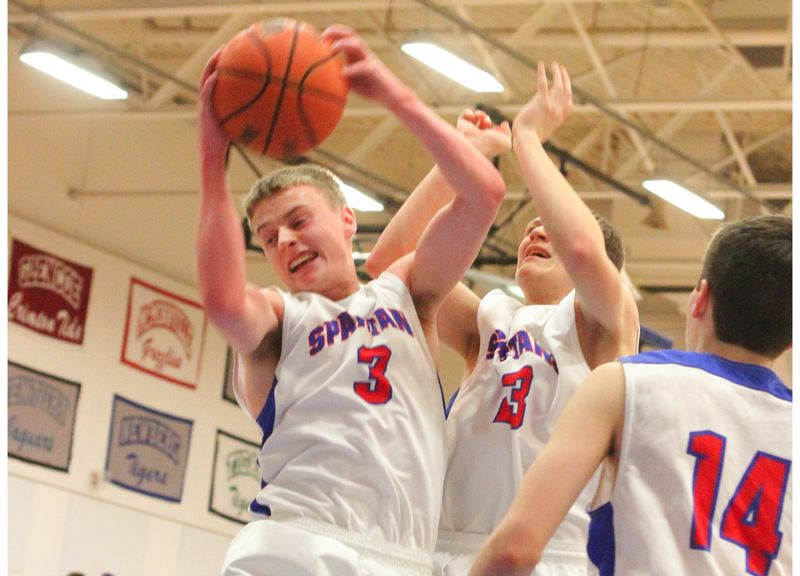 by: HILLSBORO TRIBUNE PHOTO: CHASE ALLGOOD - Hillsboro's Tyler Fernstrom corrals the ball in Hillsboros' 47-43 defeat of Glencoe.