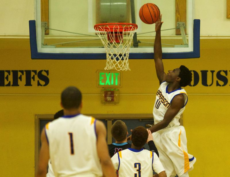 Jefferson's Quintus Hall Jr. guides his shot into the basket against Madison.