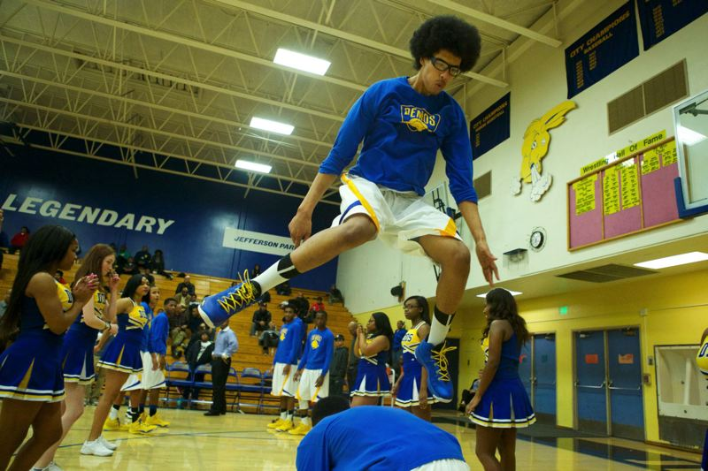 Sundi Edwards of Jefferson jumps over a teammate during the pregame introductions.