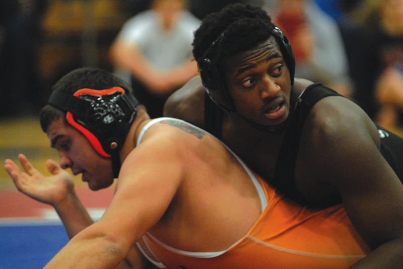 by: PAMPLIN MEDIA GROUP: DAVID BALL - David Douglas sophomore Osawaru Odighizuwa gets the upper hand on Riley Sipe of Dallas to win the 220-pound title bout.