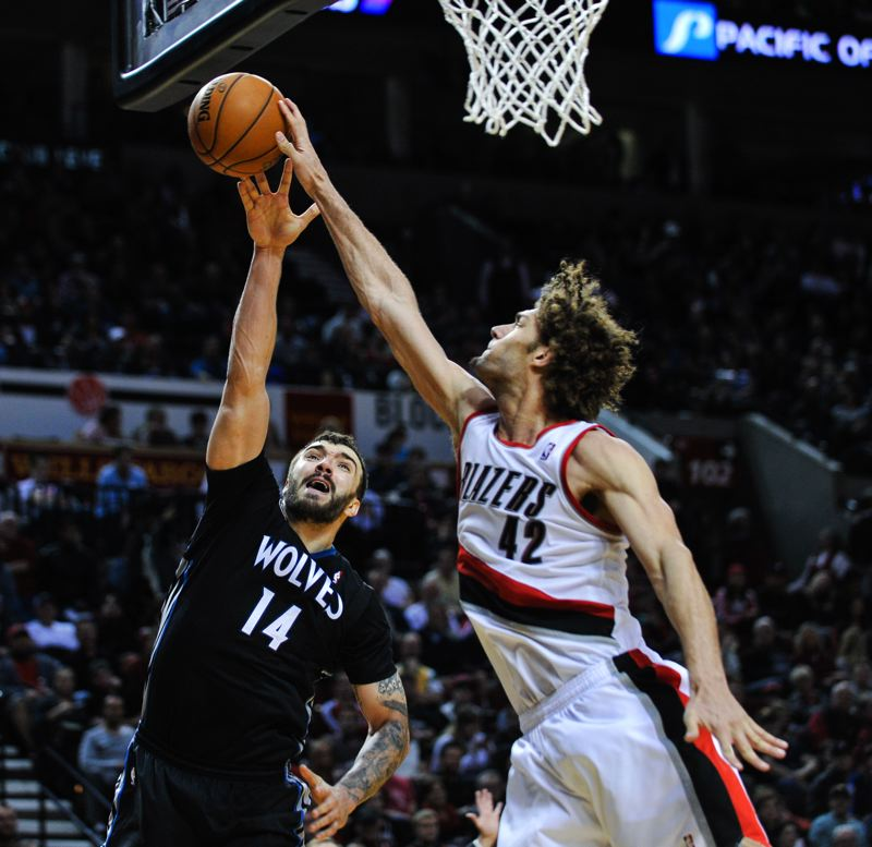 by: COURTESY OF JOHN LARIVIERE - Trail Blazers center Robin Lopez (right) extends for a block against Minnesota Timberwolves post Nikola Pekovic during Saturday night's 115-104 victory by Portland at Moda Center.