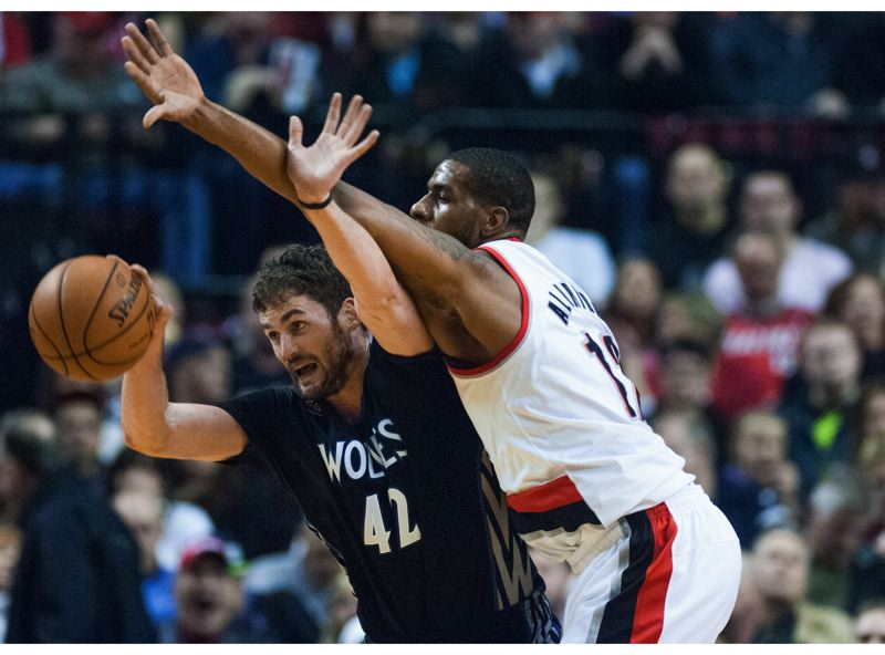by: COURTESY OF JOHN LARIVIERE - Minnesota's Kevin Love (left) protects the ball against Portland's LaMarcus Aldridge. The Trail Blazers won 115-104 Saturday night at Moda Center.