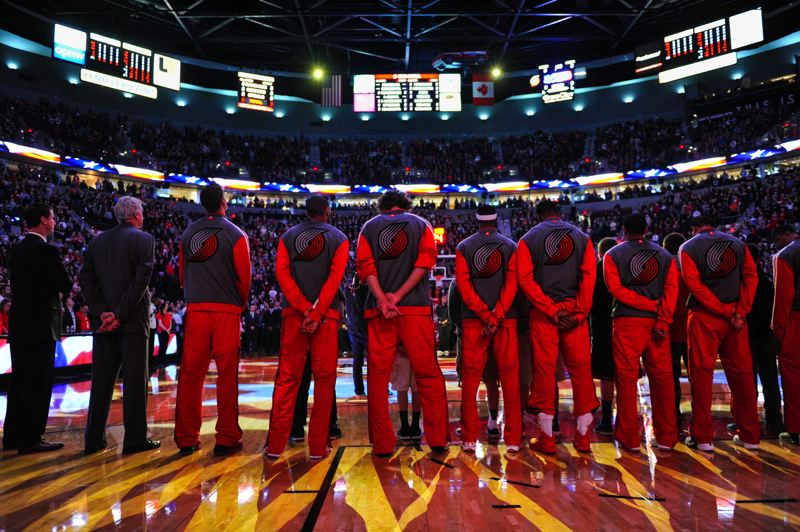 The Blazers stand for the national anthem.