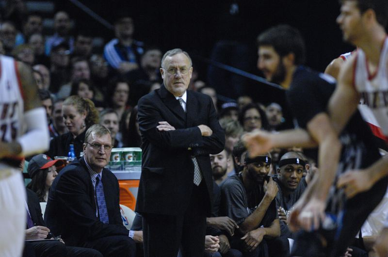 Minnesota coach Rick Adelman watches the action.