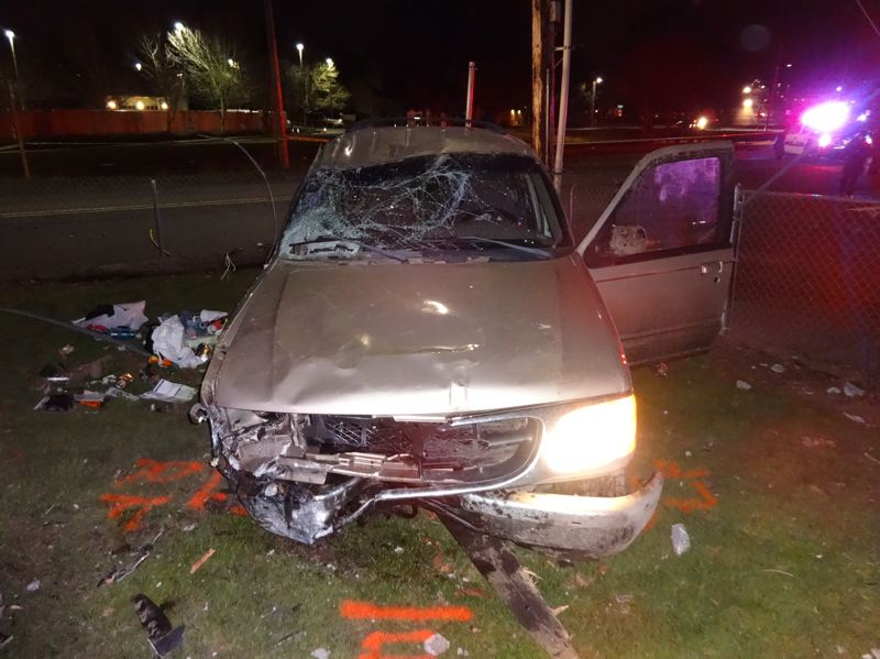 by: COURTESY OF MILWAUKIE POLICE DEPARTMENT - The driver of this Ford Explorer was seriously injured early Monday morning, Jan. 27, after a high-speed chase through Milwaukie that ended with the vehicle slamming through a power pole and damaging area railroad tracks.