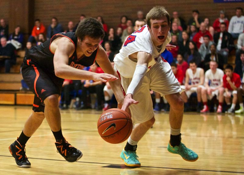 by: JAIME VALDEZ - Gladstone senior forward Andrew Conway (left) and La Salle senior wing Luke Kolln scrap for a loose ball in last weeks Tri-Valley Conference opener at Gladstone. The Falcons played tough down the stretch in a 49-39 victory.