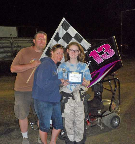 by: COURTESY OF DOCS PHOTOS - Casey Starr stands with her parents Ron and Sommer after her first win driving her 125cc Outlaw kart.