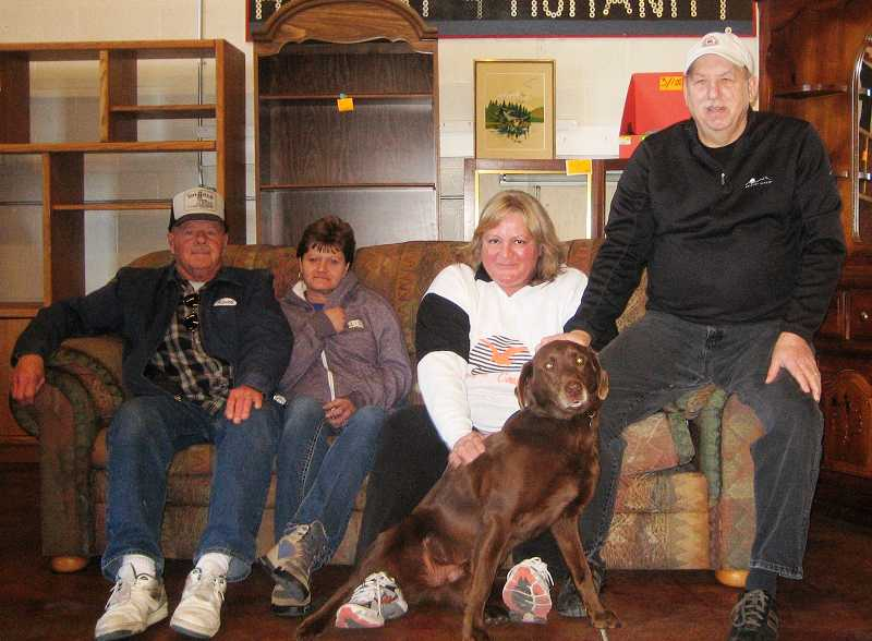 by: BILL MINTIENS - Pictured above are Prineville Re-Store team members Leland Blackburn, Yvonne Penner, Jeanne Sterling, Bill Graves, and Diesel the store mascot.
