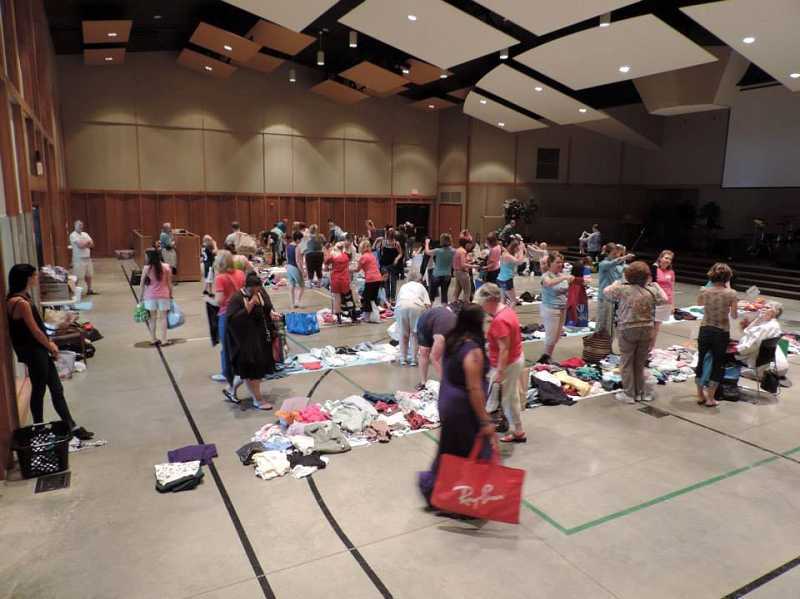 by: COURTESY COUNTRYSIDE COMMUNITY CHURCH - Here's what last's year's clothing exchange looked like at Countryside Community Church. The annual event is set for Feb. 22 this year.