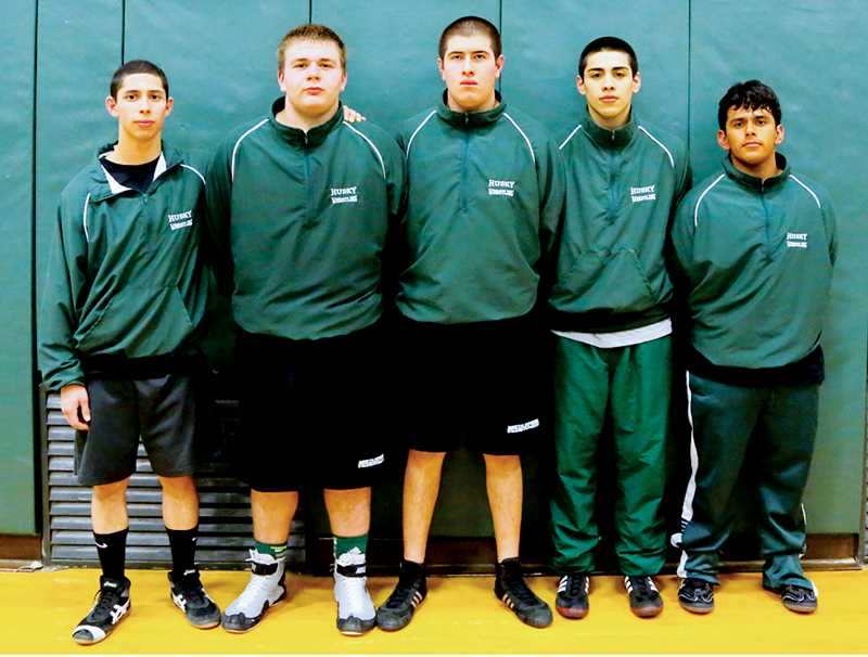 by: JO WHEAT - North Marion senior wrestlers (from left) Adam Vega, Brennan Patterson, Mario Elias, Christopher Lopez and Miguel Cuenca.