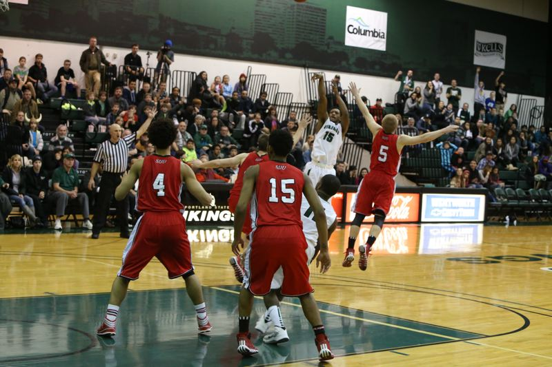by: COURTESY OF STEVE BRENNER - Portland State guard Marcus Hall puts the Vikings ahead for good with a last-minute 3-pointer against Southern Utah.