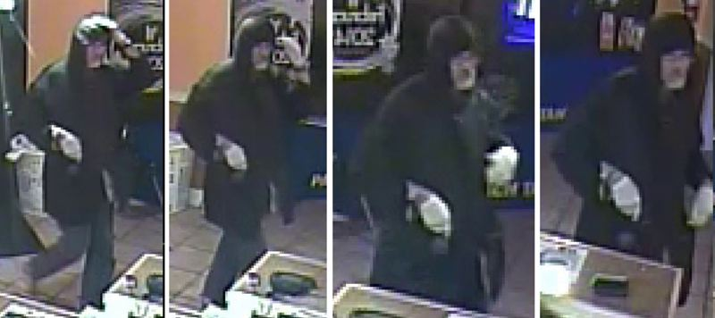 by: CLACKAMAS COUNTY SHERIFF'S OFFICE - Surveillance photos of a man who walked into a Milwaukie-area business on the night of Monday, Jan. 27, attacked an employee, and then dragged her to his van. Deputies said the victim was able to escape as he was driving away.
