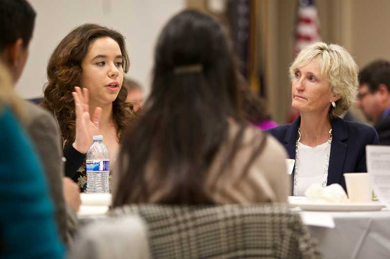 by: TIMES PHOTO: JAIME VALDEZ - Yasmine Weil-Pourfard, a Forest Grove High School senior, talks about challenges in the classroom for students during a roundtable discussion at the Washington County K-8 Education Forum.