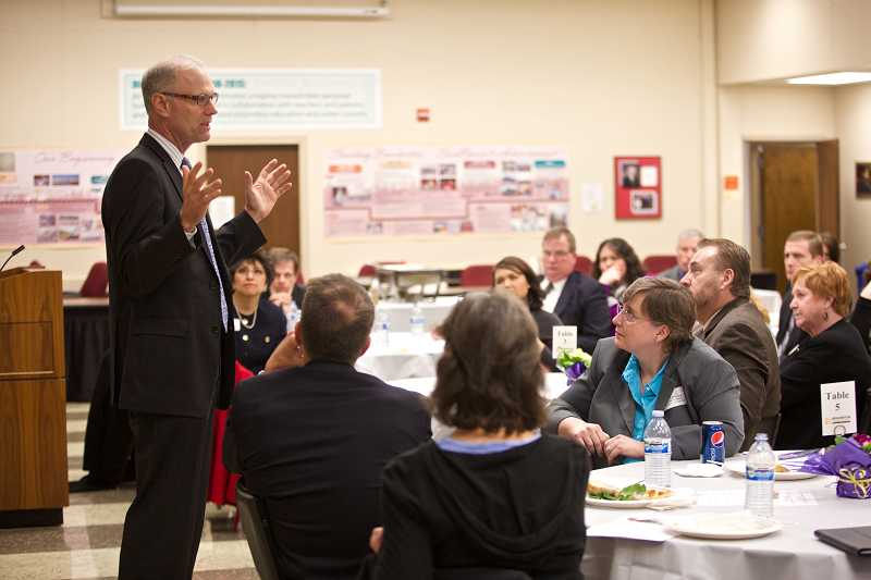 by: TIMES PHOTO: JAIME VALDEZ - Oregon Deputy Superintendent Rob Saxton talks to Washington County school district leaders about what it will take to ensure students' future academic success.