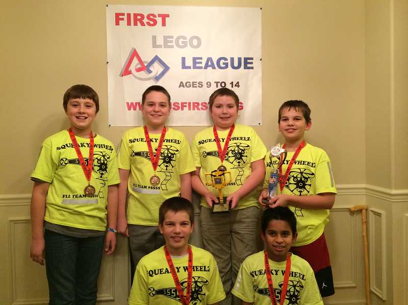 by: SUBMITTED PHOTO - Members of Wilsonville's Squeaky Wheelz team earned a second-place trophy at a state Lego robotics competition held Jan. 18. Back row, from left, Shane Bresnahan, Briggs Moore, Cameron Castillo and Logan Carpenter. Front row, from left Justin Carpenter and Sarthak Kadam.