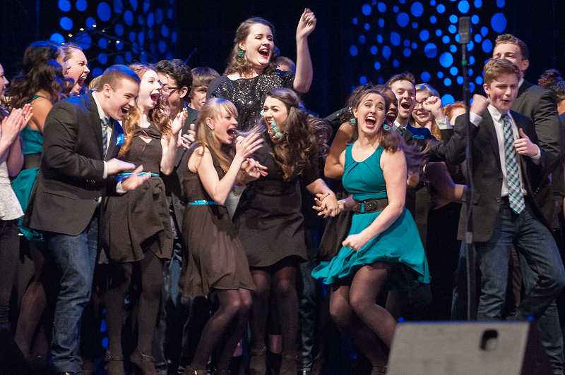 by: SPOKESMAN PHOTO: JOSH KULLA - Sou'ld Out members explode with joy Saturday, moments after it was announced the Wilsonville High School a cappella group was the winner of the International Championship of High School A Cappella Western Semifinals. The group now will compete for a national title in April in New York City.