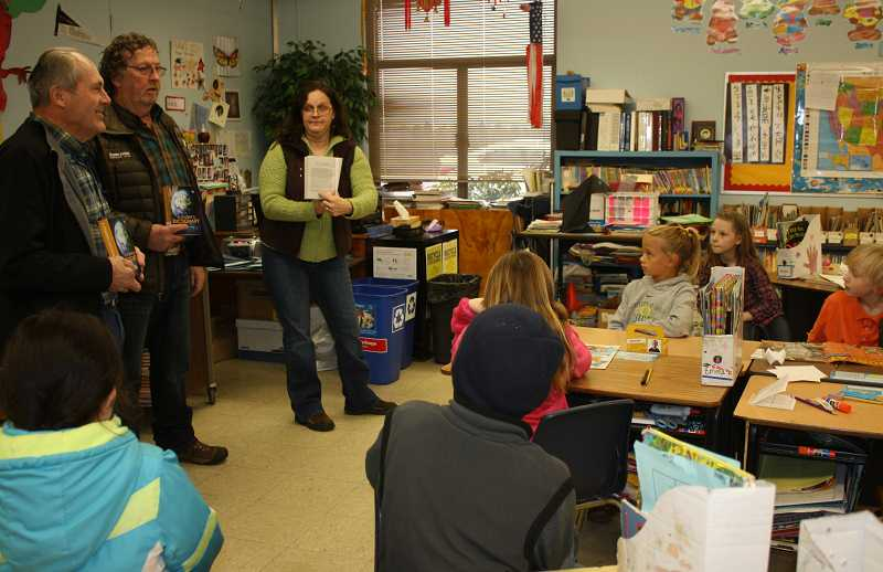 by: PEGGY SAVAGE - Don Sether, Jeff Kleiner and Teresa Forbes talk with Rural Dell third-graders about what they can find in the dictionaries before handing them out to the students.