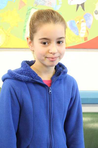 by: LINDSAY KEEFER - Lukia Melkomukov, a fourth-grader at Heritage Elementary School in Woodburn, is the only student in Oregon to receive an iPod Shuffle in a contest from Achieve3000, an online-based instructional program.