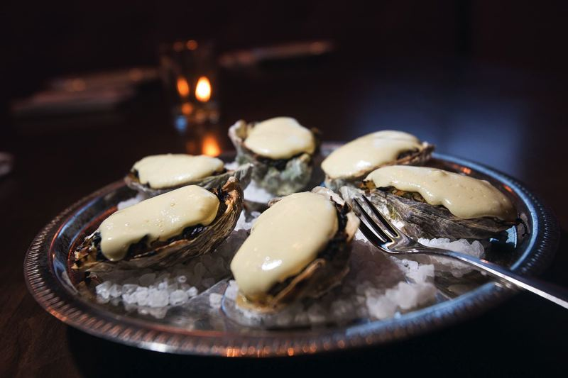 by: TRIBUNE PHOTO: JONATHAN HOUSE - The Trifecta Tavern in Southeast Portland specializes in fresh bread, vintage cocktail recipes and oyster dishes, including the Oysters Trifecta - oysters baked in their shells with leeks and hollandaise.