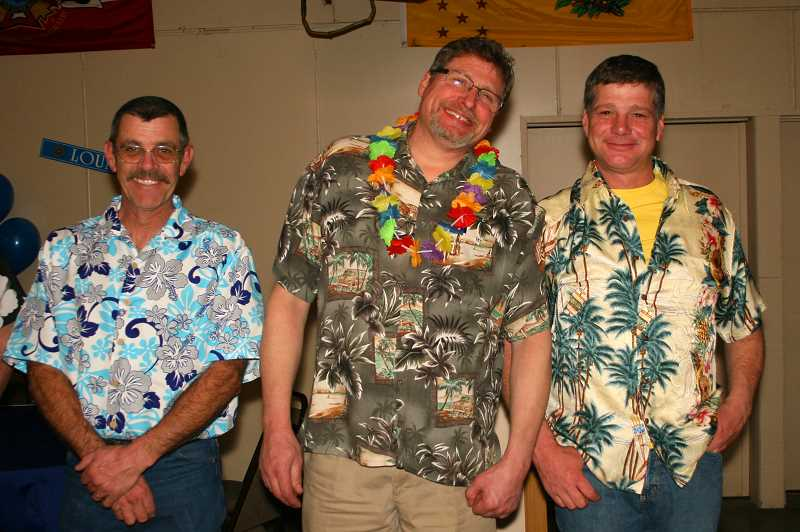 Mike Gangstead, Don Fahlgren adn Kirk Neal, left to right, all participated in the 'Ugly Tropical Shirt' contest at the CRR chamber's gala.