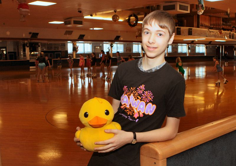 by: DAVID F. ASHTON - After competing at the World Roller Artistic Skating Championships, Charles Hamblin says his experience was perfect. The duck is one of his souvenirs of the trip.