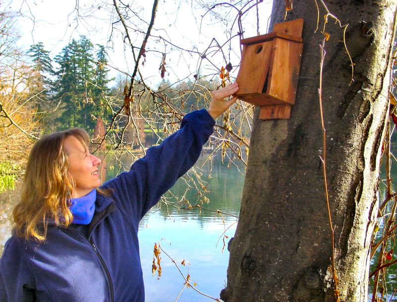 by: MERRY MACKINNON - Eastmoreland Golf Course Superintendent Kath Hauff is in the midst of an Audubon Cooperative Sanctuary Program for Golf Courses certification effort. One requirement of certification is for the golf course to do wildlife and habitat education and outreach. Here she stands next to a bird house on the links, made by local Boy Scouts.