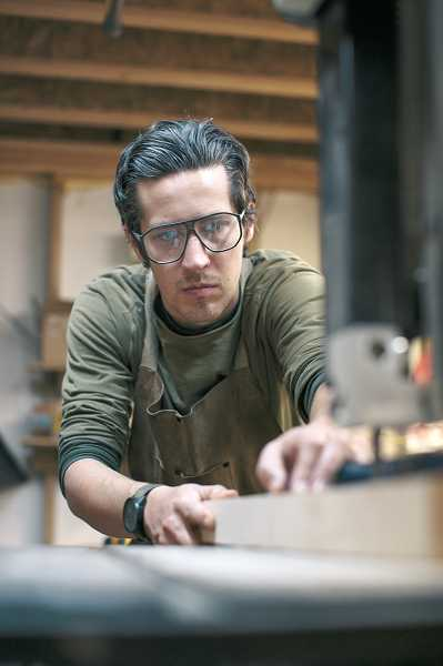 by: SUBMITTED PHOTO - Former Canby resident Eric Singer works with wood as he starts the process of producing a unique pair of sunglasses through his company, Shwood Eyewear.