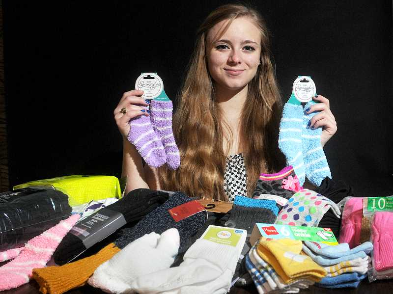 by: GARY ALLEN - Foot warmer - Devin Beeson has collected more than 1,800 pairs of socks for the homeless in Portland and Newberg for her senior project at Newberg High School. Beeson also maintains the 'Paying It Forward Tracker' Facebook page to chronicle her community service and solicit suggestions from the community.