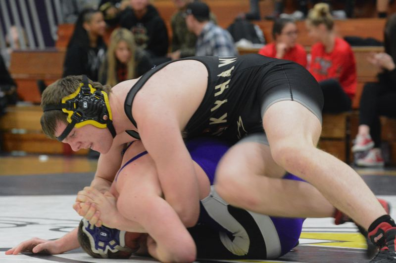by: TIMES PHOTO: MATT SINGLEDECKER - Southridges Alex James was one of three Skyhawks to beat Sunset on Thursday on the road. James beat Ellis Parr by decision.