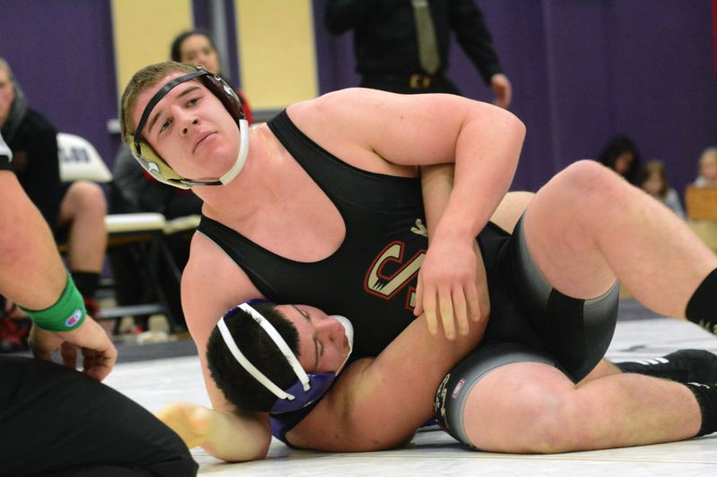 by: TIMES PHOTO: MATT SINGLEDECKER - Southridge 285-pound senior Tyler Cox was the only Skyhawk to tally a pin against Sunset, flattening the Apollos Alex Betancourt in the third round.