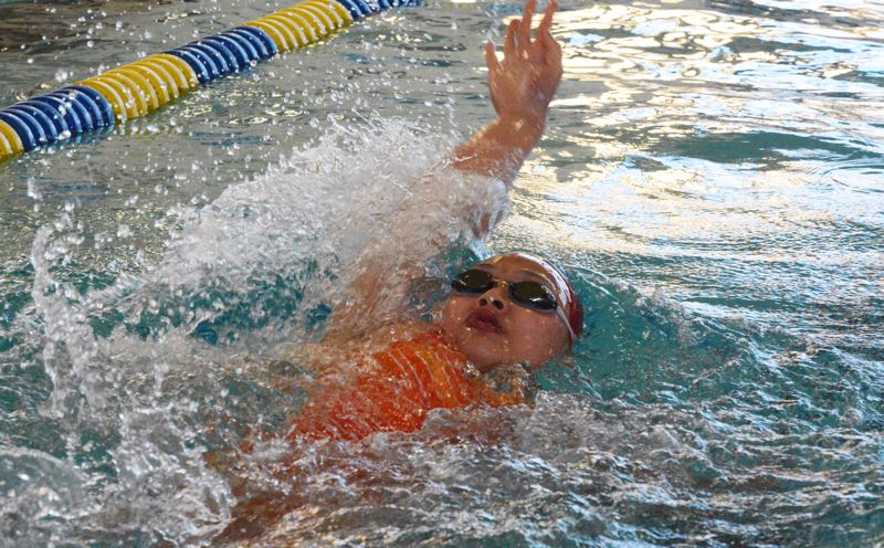 by: TIMES PHOTO: MATT SINGLEDECKER - Westview junior girls swimmer Tiffany Zhao won the 200 individual medley and the 100 breastroke against Lincoln on Thursday. Zhao also helped the Wildcat relay teams take first as well.