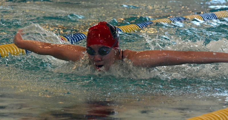 by: TIMES PHOTO: MATT SINGLEDECKER - Westview swimmer Tiffany Huang took second place in the 100 butterfly against Lincoln on Thursday.