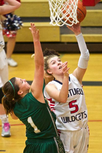 by: TIMES PHOTO: JAIME VALDEZ - Westview Wildcats point guard Ashley Scoggin (5) shoots over Jesuit Crusaders guard Kate Andersen (1) at Westview High School.