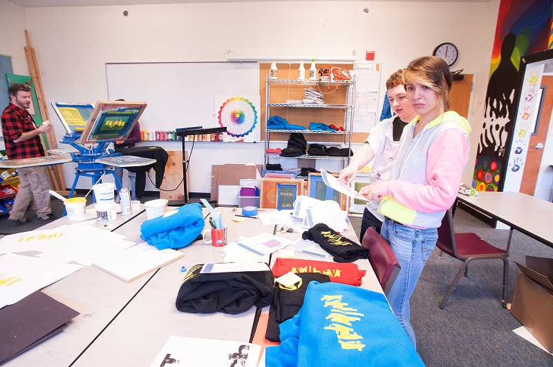 by: PAMPLIN MEDIA GROUP: JOSH KULLA - The students in Ben Whitcomb's printmaking class are learning about screenprinting and have created ATHS spirit wear to sell.