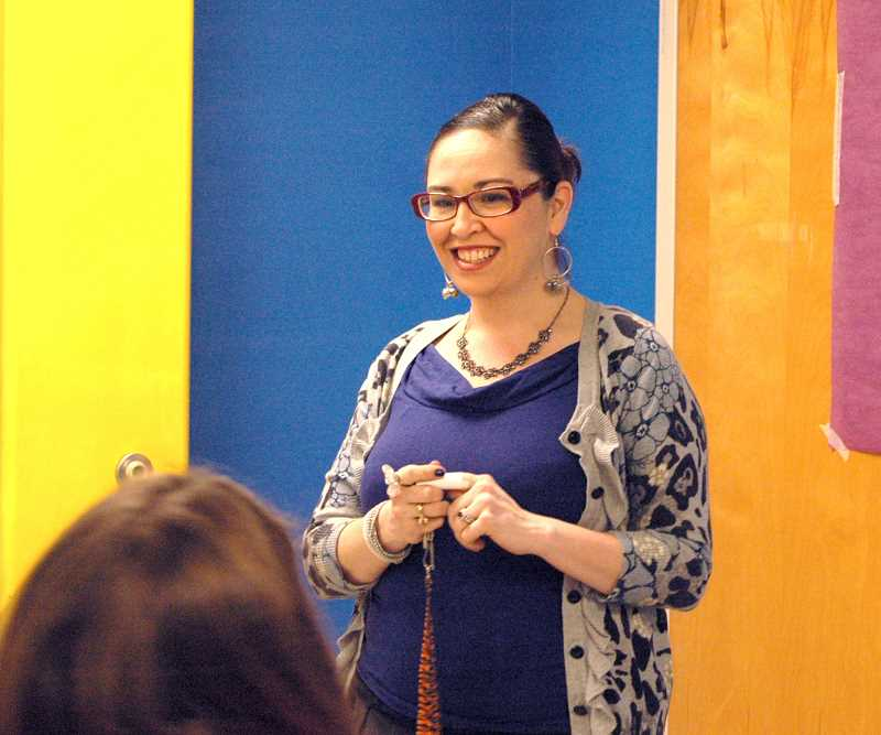 by: ISABEL GAUTSCHI - Art teacher and student council adviser Angennette Escobar cracks jokes with the students as they discuss the merits of good deeds with or without the hope or roars awards.