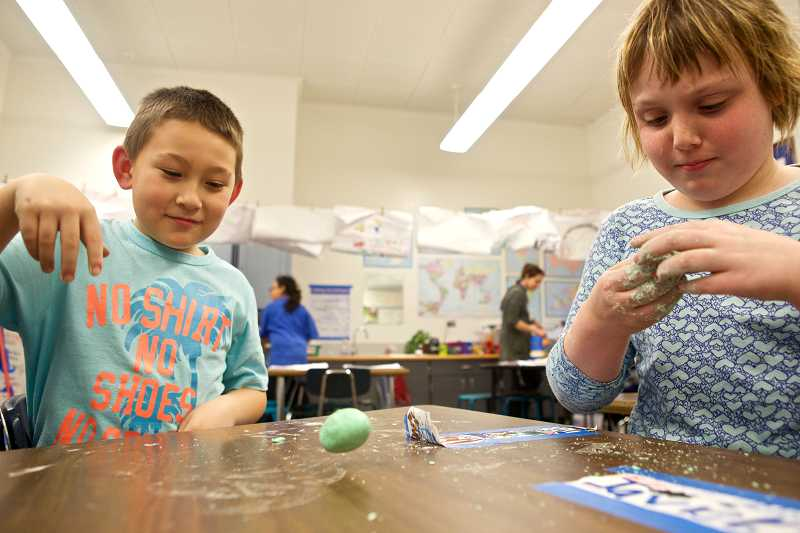 by: TIMES PHOTO: JAIME VALDEZ - Zach Lord bounces his rubber ball he made as Sydney Reynolds works on hers during the Science Stars program at McKay Elementary School.