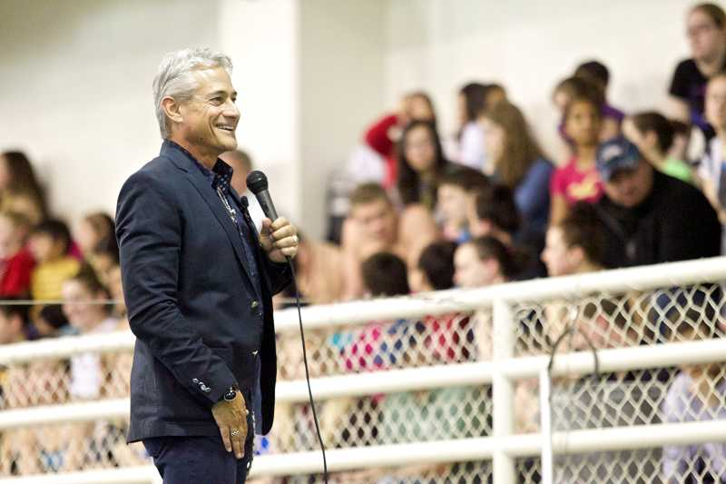 by: TIMES PHOTO: JAIME VALDEZ - Olympic gold medalist Greg Louganis speaks to junior divers from the Tualatin Hills Dive Club about how he dealt with fear when competing.