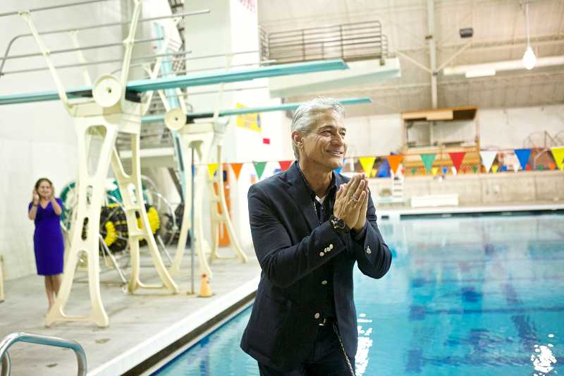 by: TIMES PHOTO: JAIME VALDEZ - Olympic gold medalist Greg Louganis thanks the junior divers from the Tualatin Hills Dive Club for singing happy birthday to him at the Tualatin Hills Aquatic Center.