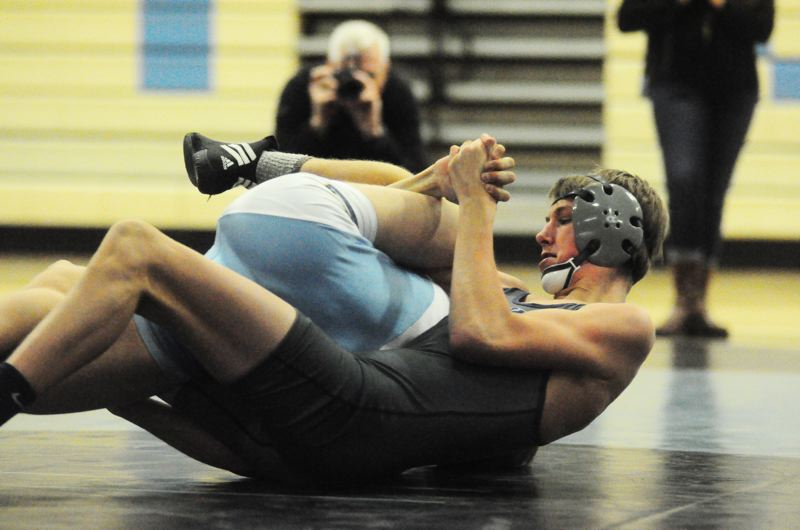 by: MATTHEW SHERMAN - Lake Oswego's Grant Van Hoomissen scored a technical fall in his match against Lakeridge last week, helping the Lakers pick up the victory.
